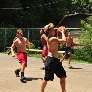 Boys playing basketball at Camp Highlander