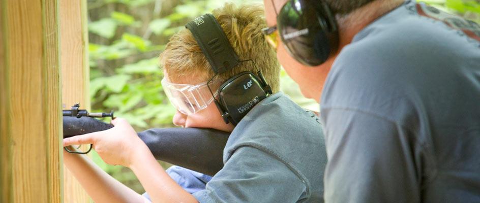A-father-teaching-his-son-riflery