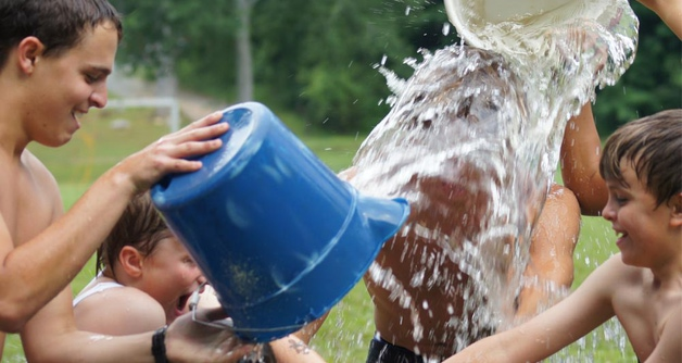 Campers take part in the great bucket sling in which everyone gets soaked.