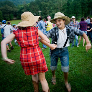 Two campers have a great time dancing at the annual square dance at camp.