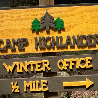 Sign for the Camp Highlander office