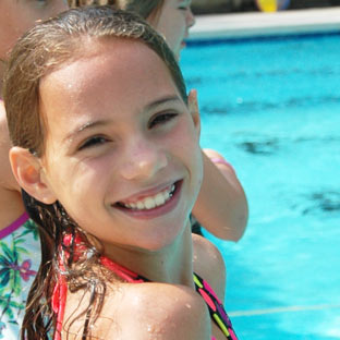 A camper looks forward to the next dip in the pool at Highlander.