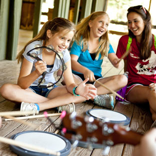 Girls play on musical instruments