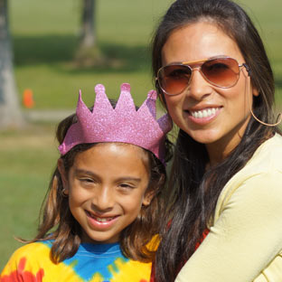 A mother holds her daughter attending a summer at Camp Highlander